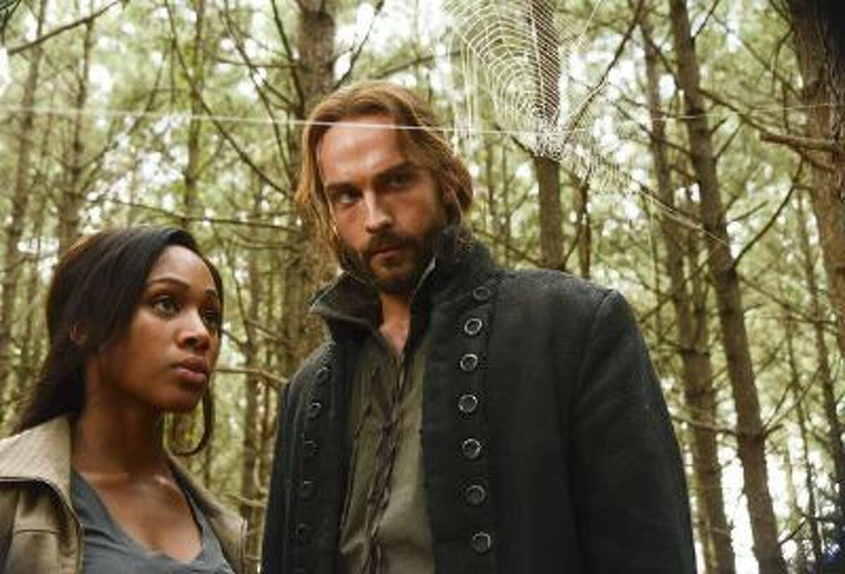 Lt. Abbie Mills (Nicole Beharie, L) and Ichabod Crane (Tom Mison, R) go on a hunt to discover an unidentified boy's origins.