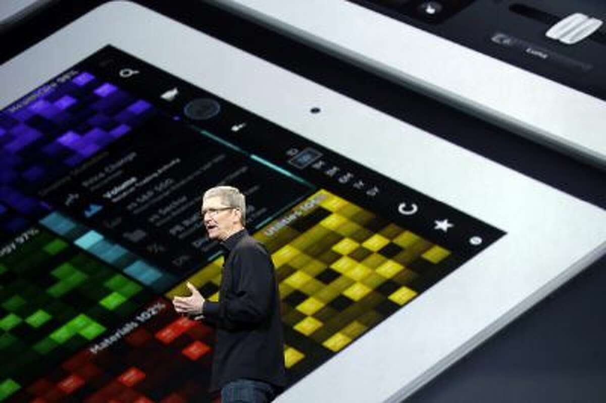 Apple CEO Tim Cook speaks on stage before a new product introduction on Tuesday, Oct. 22, 2013, in San Francisco.