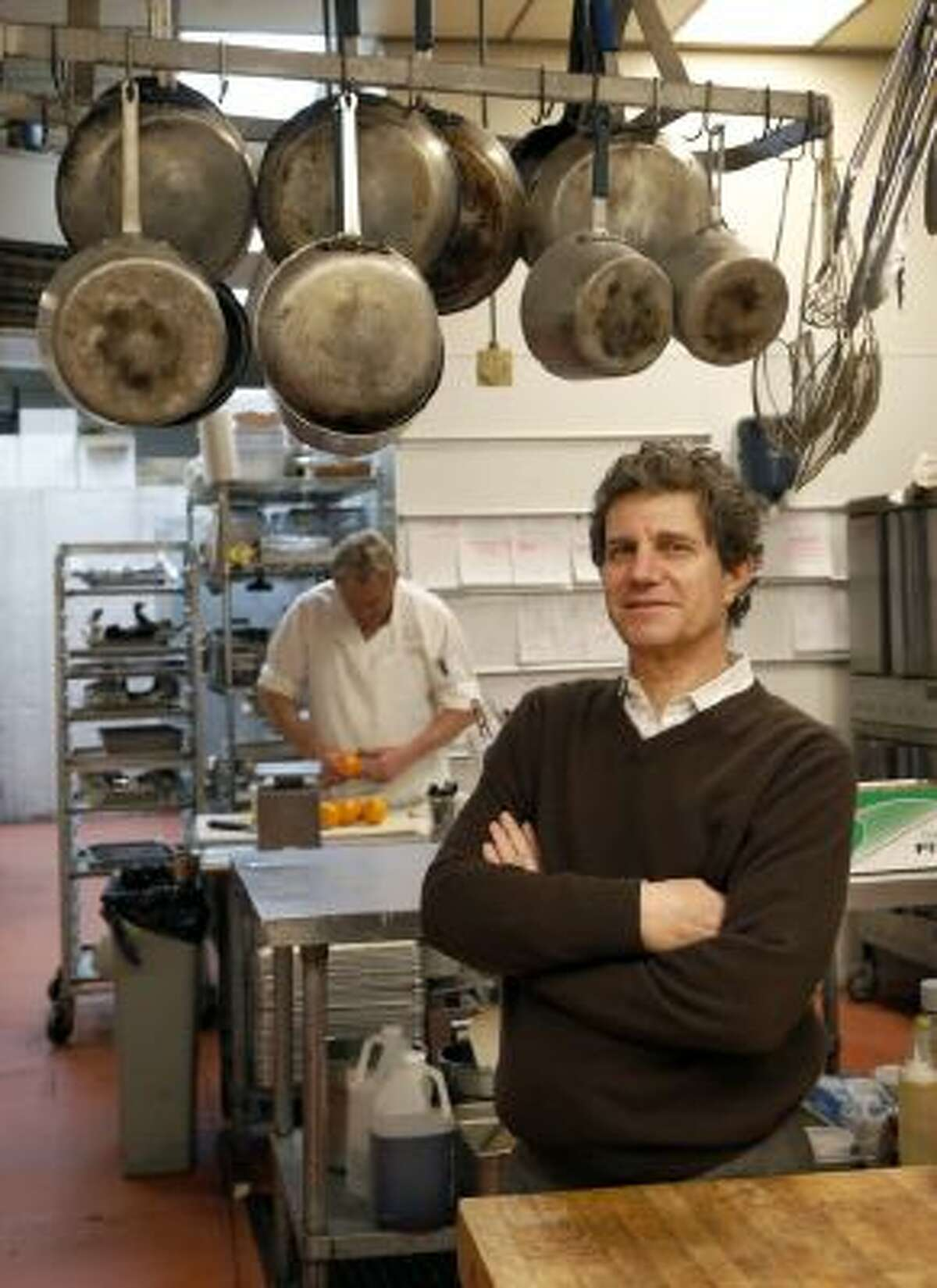 David Borris, owner of Hel's Kitchen Catering in Northbrook, Ill., poses for a photo in his company's kitchen. Borris said the health law doesn'?t affect his hiring.