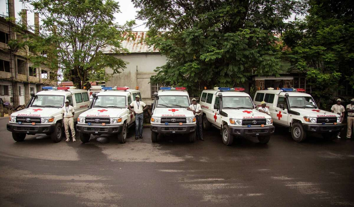 Five ambulances that were donated by the U.S. to help combat the Ebola virus are lined up following a ceremony attended by Sierra Leone's president Ernest Bai Koroma, in Freetown, Sierra Leone, Wednesday, Sept. 10, 2014. The United States donated five ambulances Wednesday to help Sierra Leoneís fight against Ebola, as the West African government acknowledged it can take up to 24 hours to pick up bodies in the spiraling crisis. (AP Photo/Michael Duff)