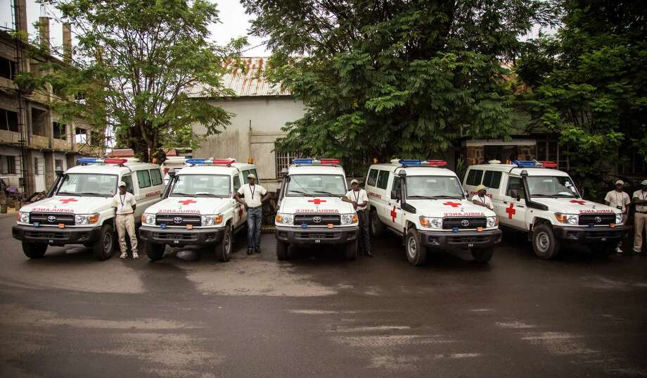 Five ambulances that were donated by the U.S. to help combat the Ebola virus are lined up following a ceremony attended by Sierra Leone's president Ernest Bai Koroma, in Freetown, Sierra Leone, Wednesday, Sept. 10, 2014. The United States donated five ambulances Wednesday to help Sierra Leoneís fight against Ebola, as the West African government acknowledged it can take up to 24 hours to pick up bodies in the spiraling crisis. (AP Photo/Michael Duff) Photo: AP / AP