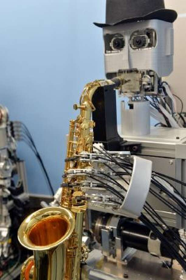 "A saxophone playing robot ""Was-3"" performs at a demonstration at Japan's Waseda University professor Atsuo Takanishi's laboratory in Tokyo on Oct. 22, 2013."