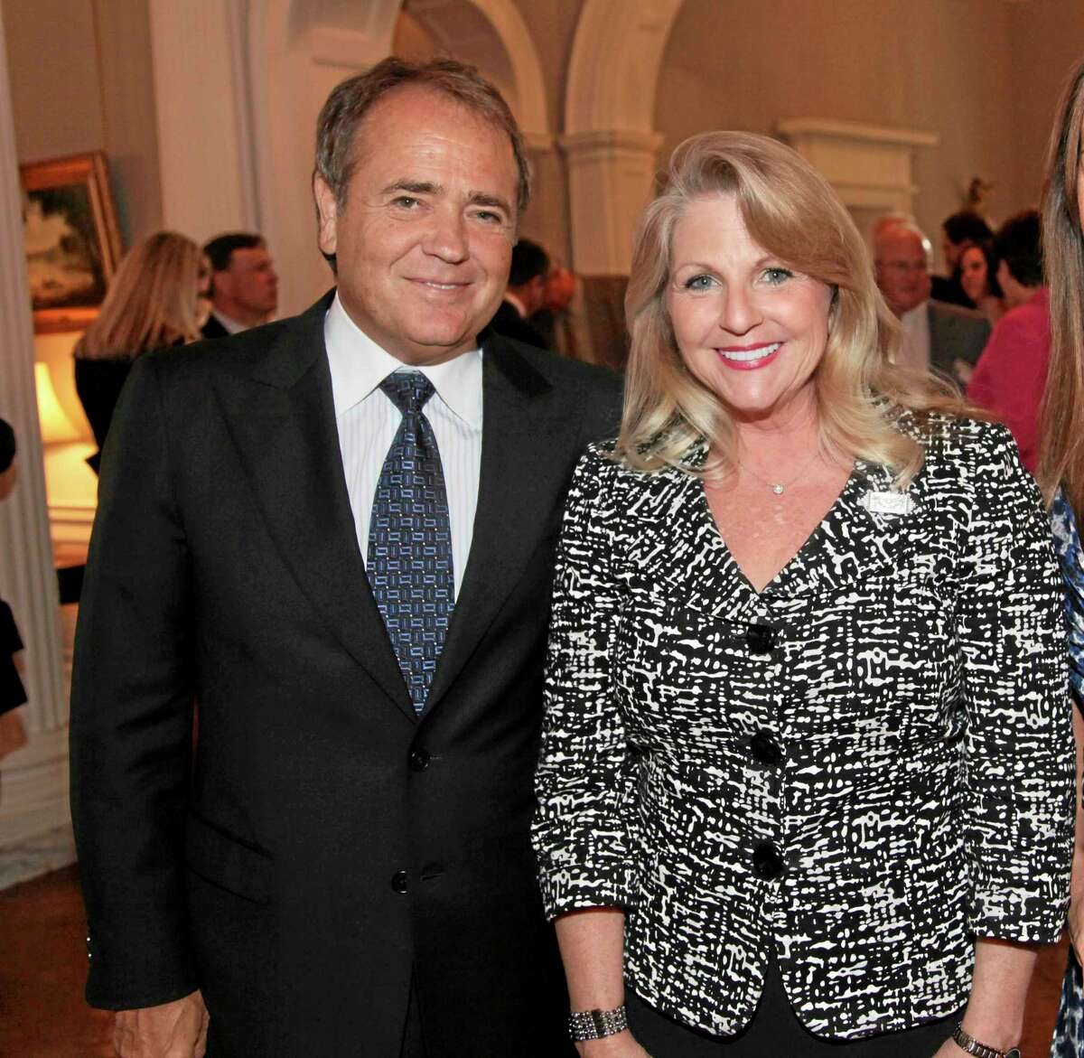 FILE - This May 5, 2011 file photo provided by the office of the Governor of Virginia shows Jonnie Williams left, and Maureen McDonnell, wife of then Gov. Bob McDonnell, during a reception for a NASCAR race at the Executive Mansion in Richmond, Va. Former Virginia Gov. Bob McDonnell and his wife were indicted Tuesday, Jan. 21, 2014, on corruption charges after a monthslong federal investigation into gifts the Republican received from Williams. (AP Photo/Office of the Governor of Virginia, Michele White, File)