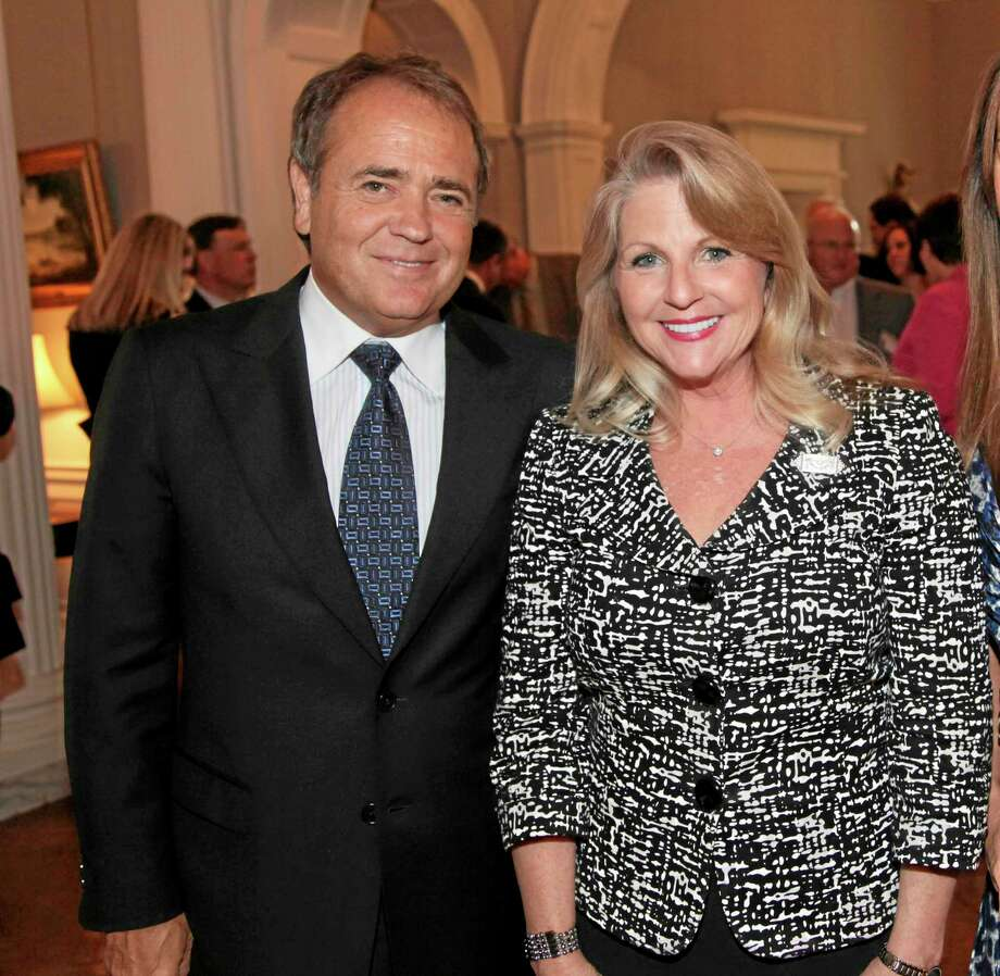 FILE - This May 5, 2011 file photo provided by the office of the Governor of Virginia shows Jonnie Williams left, and Maureen McDonnell, wife of then Gov. Bob McDonnell, during a reception for a NASCAR race at the Executive Mansion in Richmond, Va. Former Virginia Gov. Bob McDonnell and his wife were indicted Tuesday, Jan. 21, 2014, on corruption charges after a monthslong federal investigation into gifts the Republican received from Williams.  (AP Photo/Office of the Governor of Virginia, Michele White, File) Photo: AP / Office of the Governor of Virginia