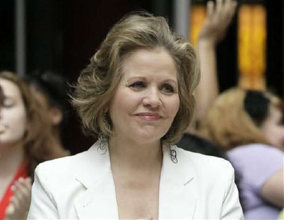 This March 19, 2012 file photo shows opera singer Renee Fleming in the rotunda of the State of Illinois building, the James R. Thompson Center, in Chicago. Fleming, a four-time Grammy winner, will perform sing the national anthem before the Denver Broncos take on the Seattle Seahawks at MetLife Stadium in East Rutherford, N.J. on Feb 2. Photo: ASSOCIATED PRESS / AP2012