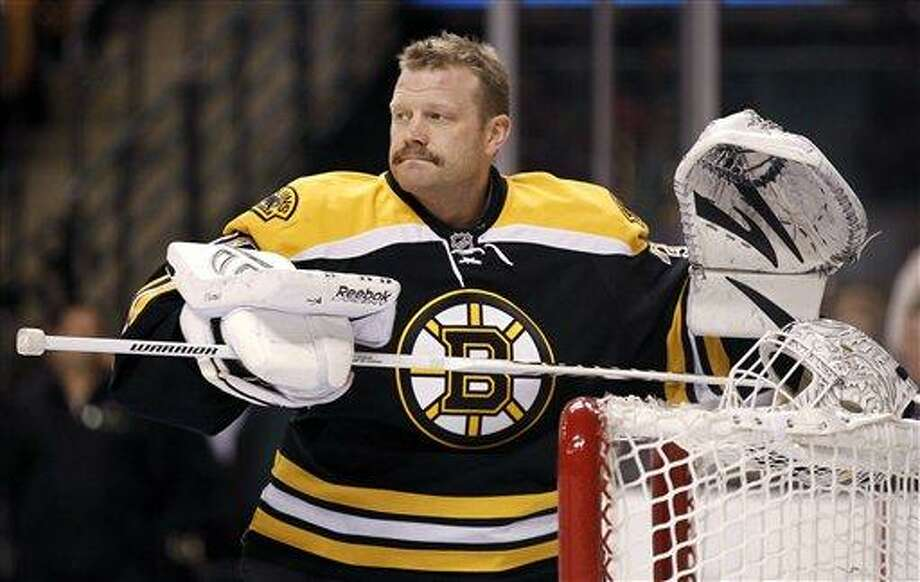 FILE - In this February 2012 file photo, Boston Bruins goalie Tim Thomas gets ready for an NHL hockey game between the Bruins and the Pittsburgh Penguins in Boston. Thomas, who has said he won't play this season, was traded by the Boston Bruins to the New York Islanders on Thursday, Feb. 7, 2013, for a conditional second-round draft choice either next year or in 2015. (AP Photo/Winslow Townson, File) Photo: ASSOCIATED PRESS / A2012