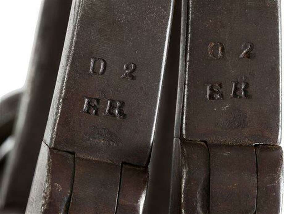 """This June 17, 2013 provided by Heritage Auctions, shows a close-up of the leg irons that were placed on John Brown shortly after his arrest at Harper's Ferry, <a href=""""http://W.Va"""">W.Va</a>. The irons are stamped """"ER"""" in two places. The initials """"ER"""" stand for Elijah Rickard, a well-known locksmith who operated out of Shepherdstown, Virginia.  believed to be those used on John Brown during his incarceration at the Charlestown, <a href=""""http://W.Va"""">W.Va</a>., jail following his arrest during the raid at Harper's Ferry <a href=""""http://W.Va"""">W.Va</a>. John Brown's capture of the Federal Arsenal at Harper's Ferry on Oct. 17, 1859 as part of a failed attempt to incite a slave uprising is seen by most historians as the spark that ignited the Civil War. They have been passed down in the family of John Boling, of Idaho, for six generations, after being obtained by a decedent shortly after Brown's execution. They are expected to bring more than $10,000 when they come up for auction on June 22, 2013. (AP Photo/Heritage Auctions) Photo: AP / Heritage Auctions"""