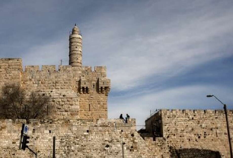 In this March 7, 2012 photo, a couple sits next to the Tower of David on the wall surrounding Jerusalem's old city.