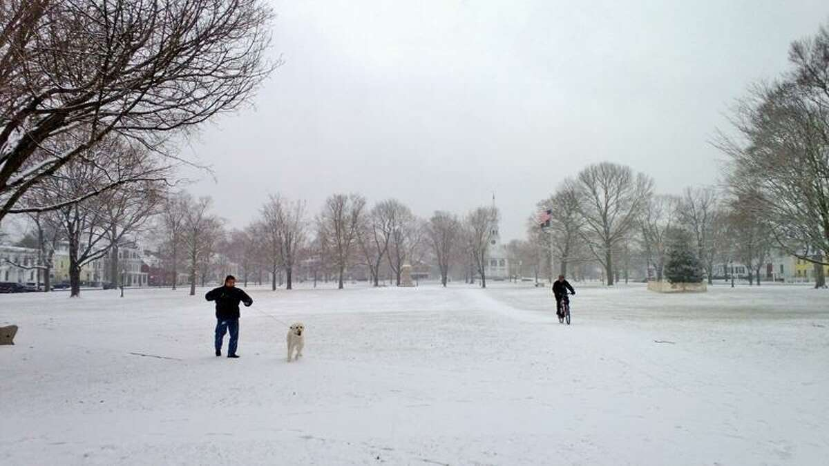 Snow falls on the Guilford Green around 9 a.m. Friday. Neal McNamara/Register