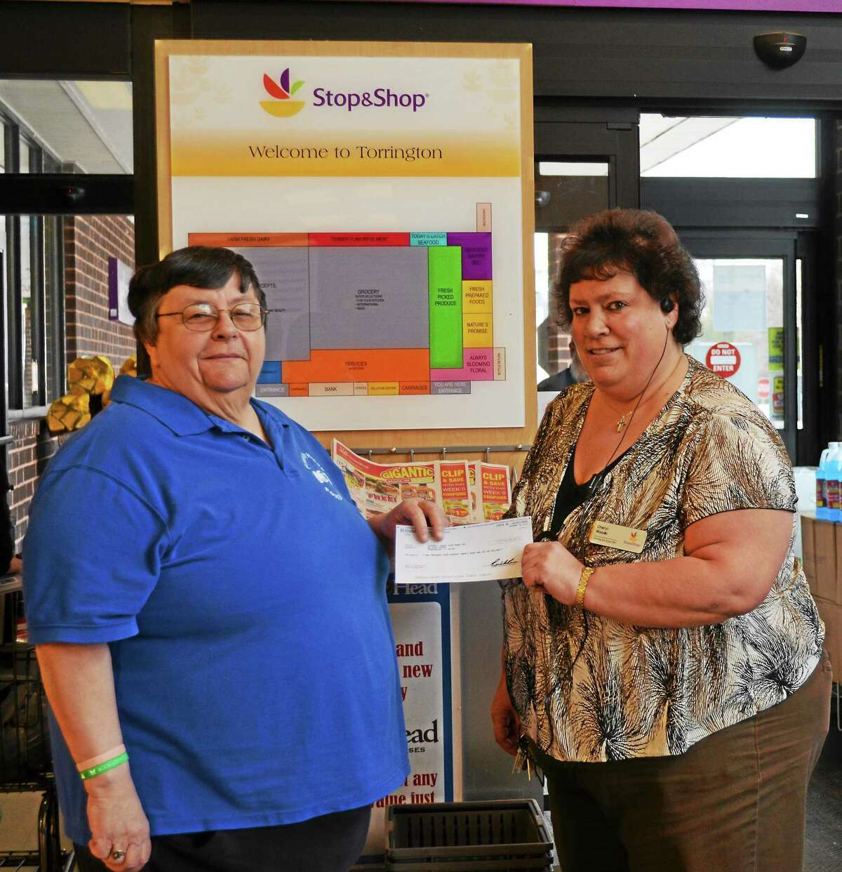 """Maureen """"Moe"""" Hubert (left) receives check from High Street's Stop and Shop store manager Cheryl Woodin (right)."""