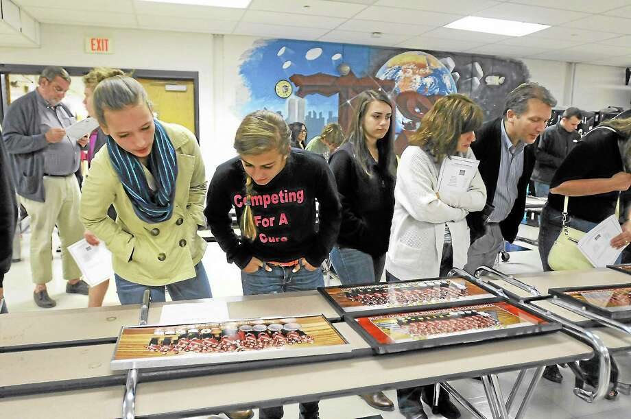 Students look over some of the memorabilia on display before the band awards ceremony on Tuesday. Photo: Laurie Gaboardi - Register Citizen