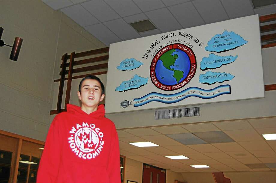 Zach Shemms, 17, painted a mural representing the core values of Region 6. Photo: Ryan Flynn — Register Citizen