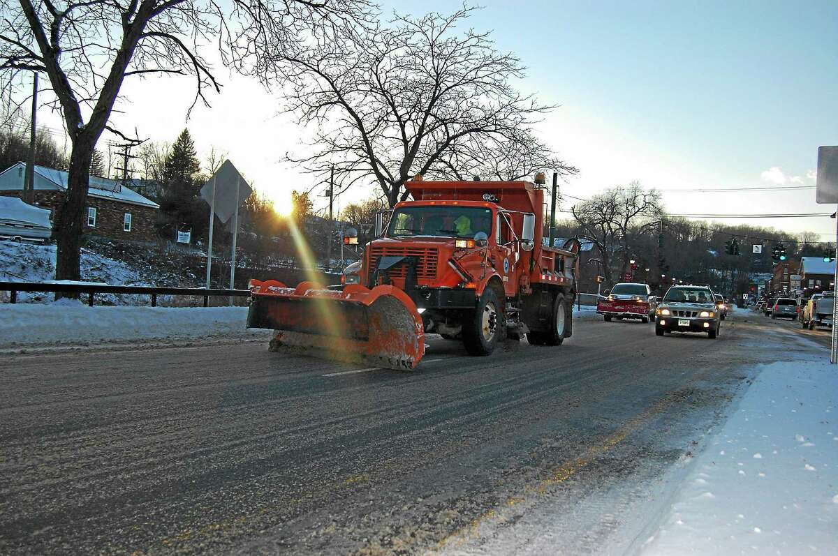 A plow travels along Main Street in Winsted in January as the town cleaned the streets in frigid temperatures following a Thursday night snowstorm.