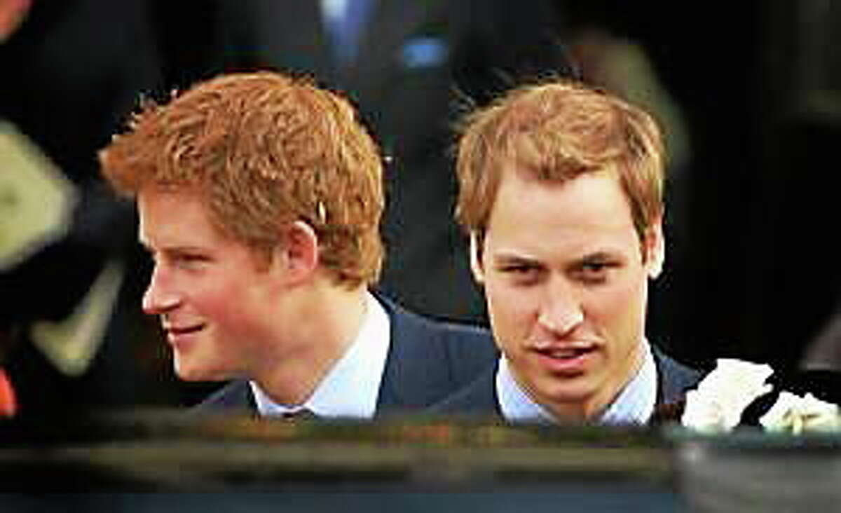 Prince William and Prince Harry leave HRH Queen Elizabeth II and Prince Phillip, The Duke of Edinburgh's 60th Diamond Wedding Anniversary celebration in Westminster Abbey on November 19, 2007, in London, England.