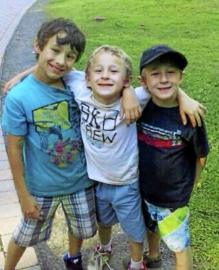 This undated family photo released by the Vernon, Conn., Police Department shows Ryan, Dylan and Brandan Lewis, subjects of a multi-state Amber Alert search on Tuesday, May 12, 2014. Photo: (Family Photo Via Vernon Police Department) / Family photo via Vernon Police Department