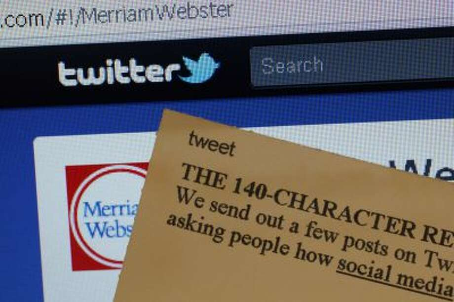 "This Aug. 24, 2011 photo displays an index card with the entry ""tweet"" next to a computer screen showing the Twitter website, at the Merriam-Webster headquarters in Springfield, Mass. Photo: AP / AP2011"