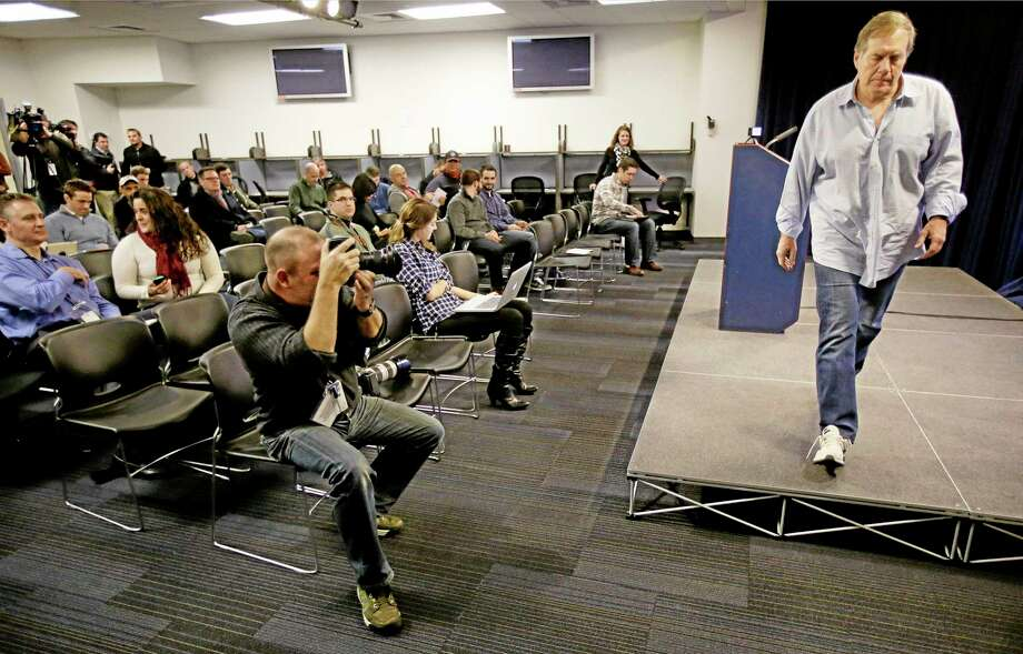Patriots head coach Bill Belichick walks off the podium for the last time this season at the team's facility in Foxborough, Mass., on Monday. Photo: Stephan Savoia — The Associated Press  / AP