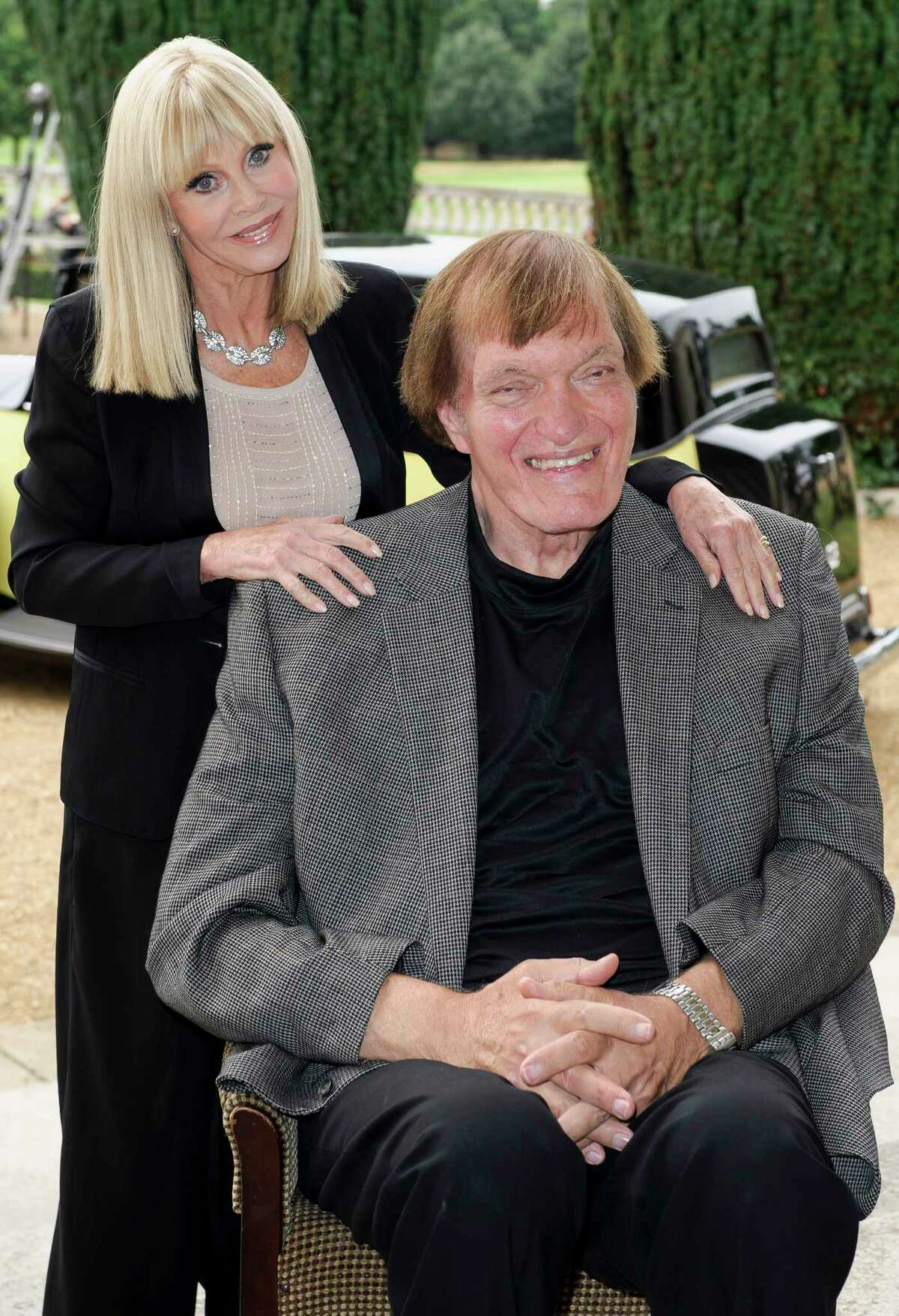 """FILE - In this Sept. 21, 2012 file photo, from left, Britt Ekland and Richard Kiel attend a photocall for the """"Bond 50"""" anniversary in London. Kiel, the towering actor best known for portraying steel-toothed villain Jaws in a pair of James Bond films, has died. He was 74."""