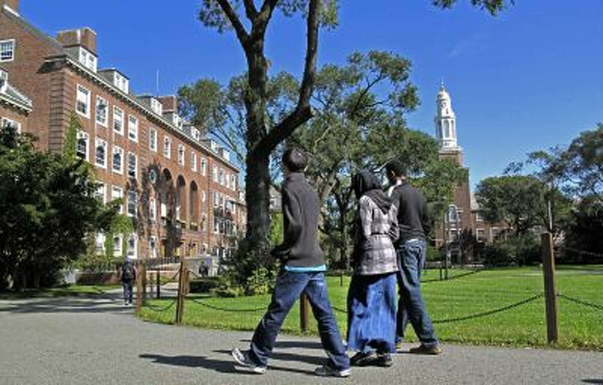 People walk on the campus of Brooklyn College in the Brooklyn borough of New York.