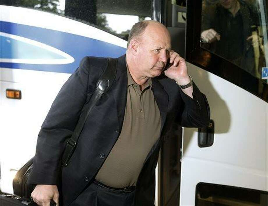Boston Bruins head coach Claude Julien arrives at the team's hotel Friday, June 21, 2013 in Chicago. The Bruins face the Chicago Blackhawks in Game 5 of the Stanley Cup Final on Saturday. (AP Photo/Charles Rex Arbogast) Photo: AP / AP