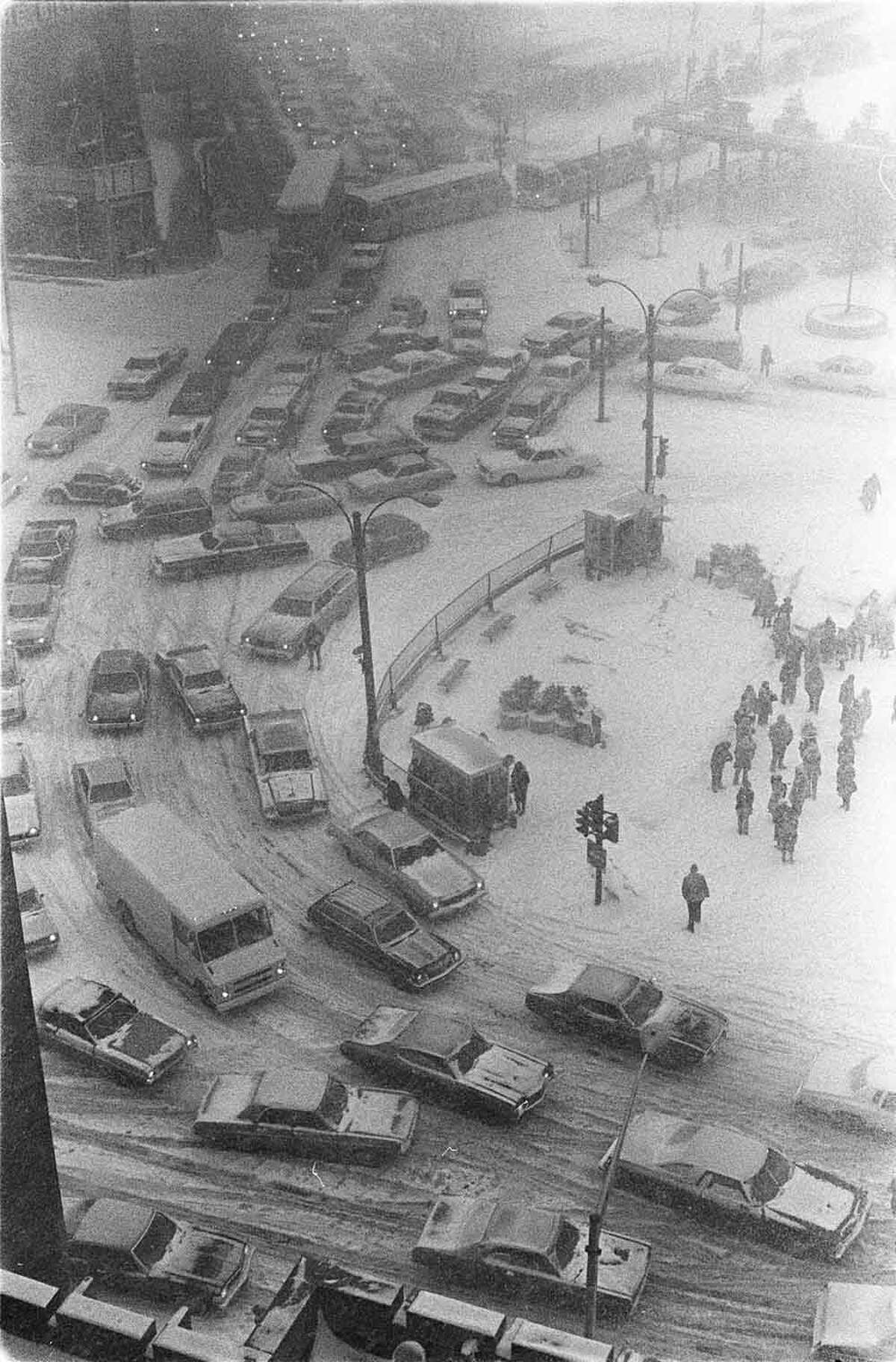 Traffic snarls around Kennedy Plaza in downtown Providence, R.I., on the afternoon of Feb. 6, 1978, the first day of the 1978 blizzard. The 24-hour storm that pounded the Northeast, crippled Rhode Island for more than a week, cutting off power, closing the airport and straining state resources. (AP Photo/The Providence Journal, Richard Benjamin)