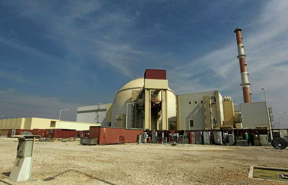 FILE -- This Tuesday, Oct. 26, 2010 file photo, shows the reactor building of the Bushehr nuclear power plant just outside the southern city of Bushehr, Iran. Iranian state TV on Monday, Jan. 20, 2014 announced the country has started implementing a landmark deal struck between six world powers and Tehran to ease Western sanctions in exchange for Iran opening its nuclear program to international inspection and limiting its uranium enrichment, which is a possible pathway to nuclear arms. (AP Photo/Mehr News Agency, Majid Asgaripour, File) Photo: AP / Mehr News Agency