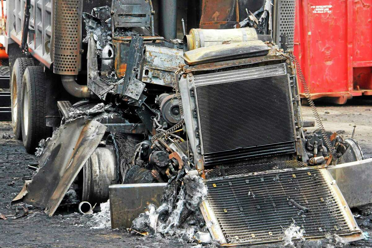 The engine one of the three trucks destroyed by an early-morning blaze parked on a lot at Mountain Top Trucking Tuesday in Torrington.