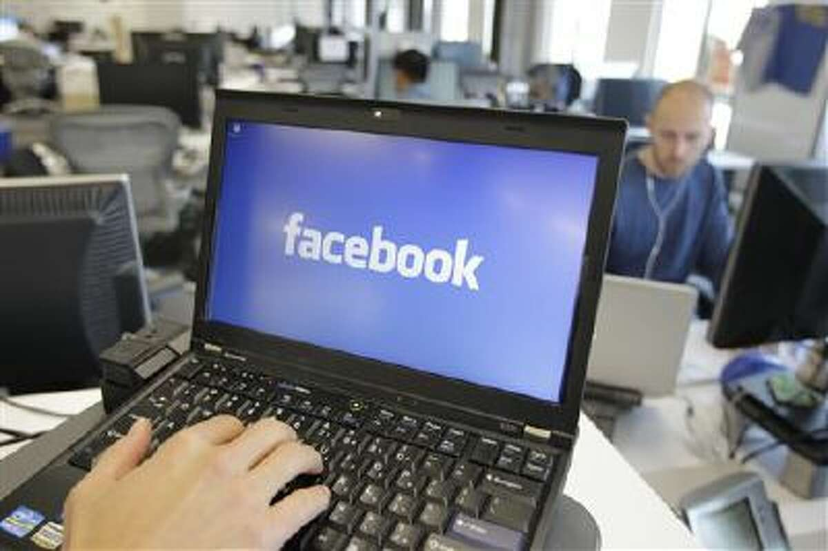 Facebook announced Tuesday it is working on new ways to keep users from stumbling across gruesome content on its website following an outcry over the discovery of beheading videos there. (AP Photo/Paul Sakuma, File)
