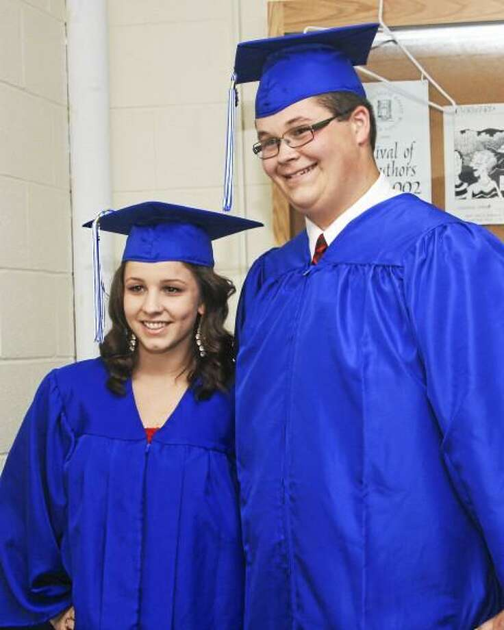 Salutatorian Kayla Conti and Valedictorian Jack Sidoti pose at graduation, photo by Fazzino Photography in Torrington