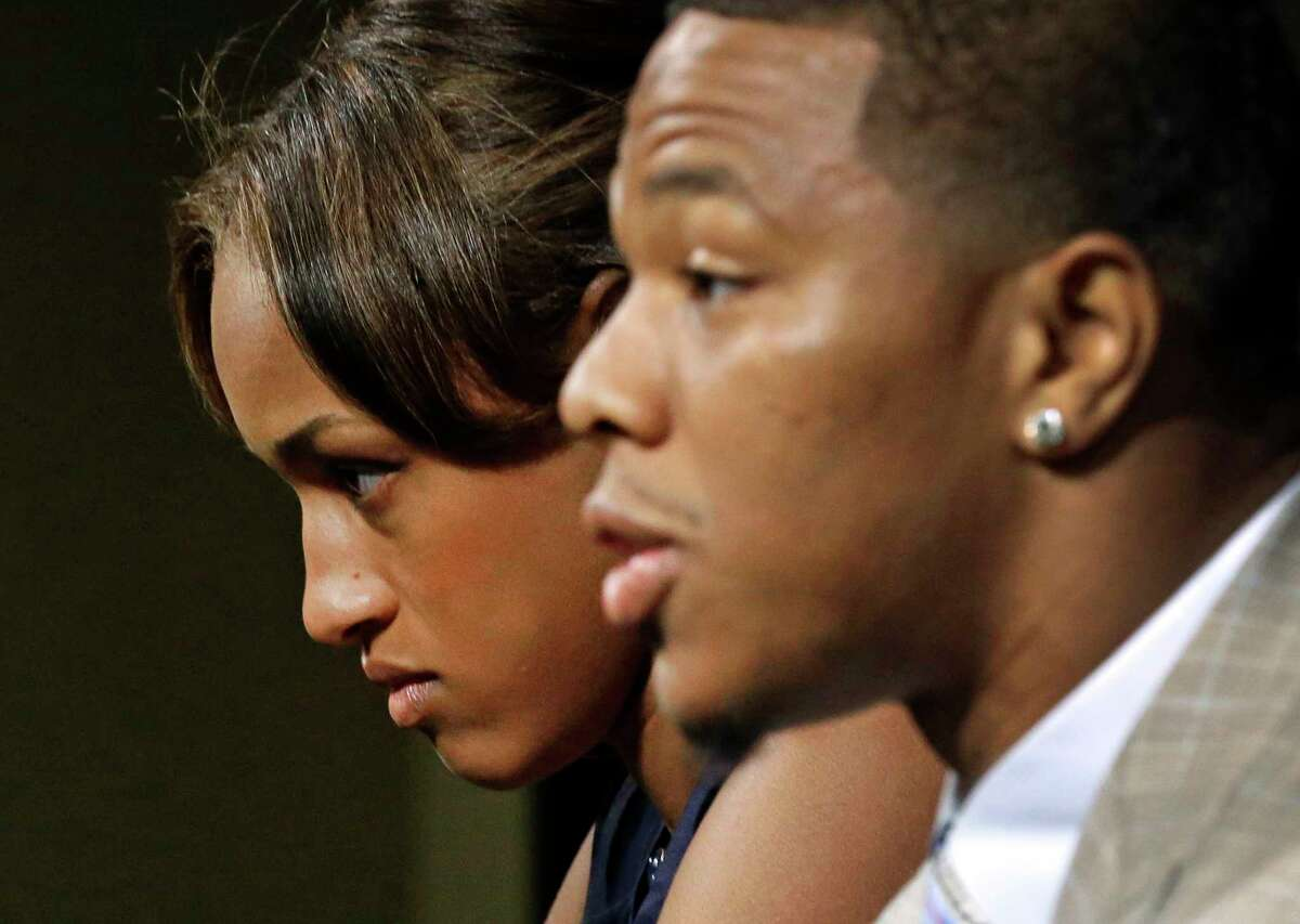 In this May 23, 2014 file photo, Janay Rice, left, looks on as her husband, Baltimore Ravens running back Ray Rice, speaks to the media during a news conference in Owings Mills, Md.