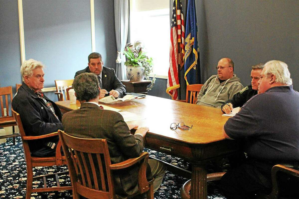 State Rep. Jay Case (left) spearheads a discussion on cell reception with local officials on Jan. 15.
