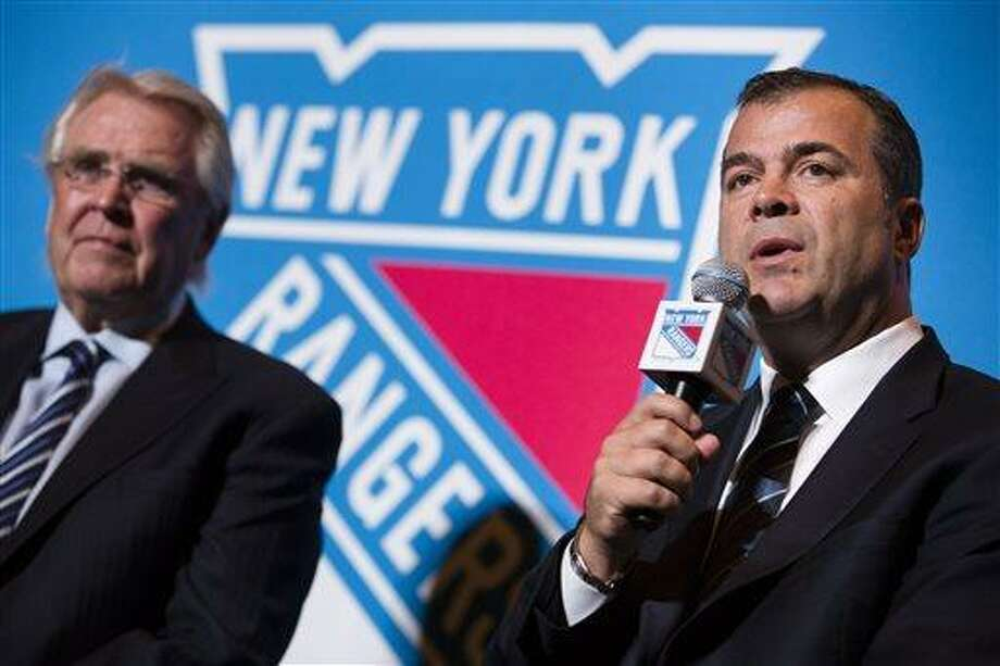 New York Rangers new hockey head coach Alain Vigneault, right, speaks during a news conference alongside Rangers president and general manager Glen Sather, at Radio City Music Hall, Friday, June 21, 2013, in New York. Vigneault, 52,  comes to the Rangers after seven years as coach of the Vancouver Canucks. (AP Photo/John Minchillo) Photo: AP / FR170537 AP