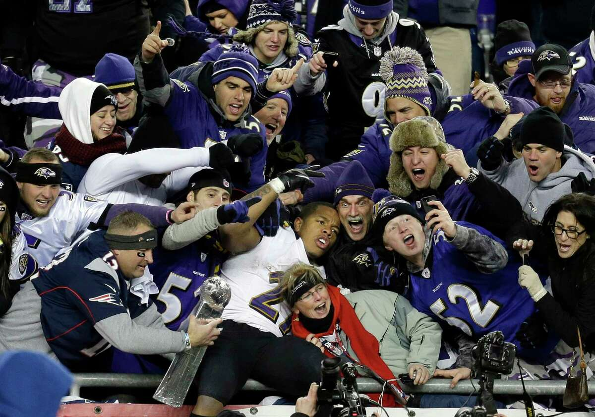 In this Jan. 20, 2013, file photo, Baltimore Ravens running back Ray Rice is surrounded by fans in the stands as he celebrates winning the AFC championship game against the New England Patriots in Foxborough, Mass.