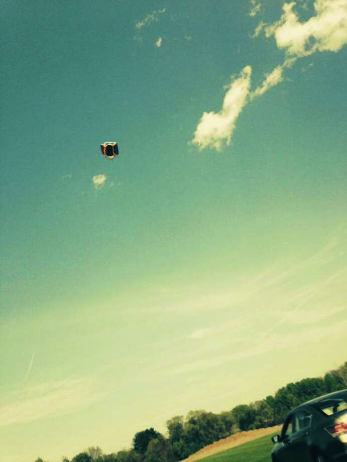 This Instagram photo, captured by a witness, shows the bounce house sent flying by a gust of wind, seriously injuring three children. Photo: Journal Register Co.