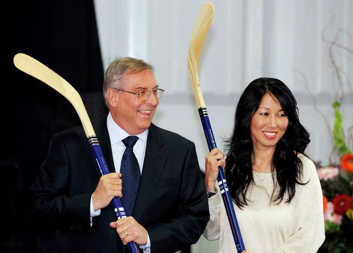 In this April 13, 2013 file photo, Sabres owner Terry Pegula and his wife, Kim, pose for cameras during groundbreaking ceremonies at First Niagara Center in Buffalo, N.Y.
