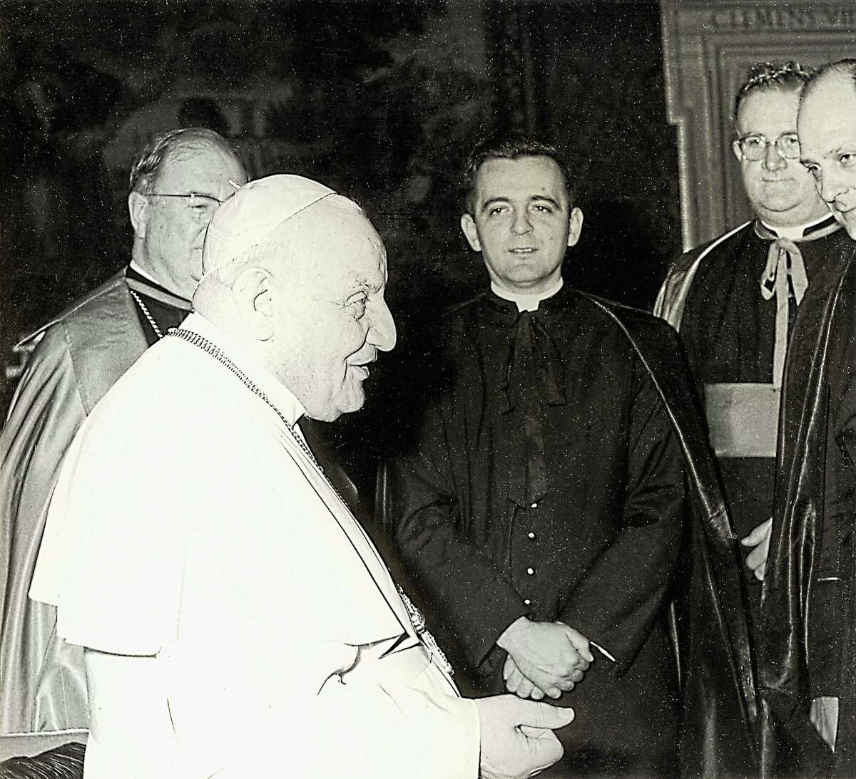 Retired Hartford Archbishop Daniel Cronin, then a priest, was an official in the Vaticanís diplomatic corps under Pope John XXIII, with whom he is shown here. Later, he was appointed Archbishop of Hartford by Pope John Paul II. (contributed photo)