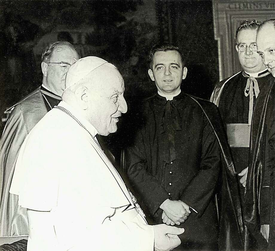 Retired Hartford Archbishop Daniel Cronin, then a priest, was an official in the Vaticanís diplomatic corps under Pope John XXIII, with whom he is shown here. Later, he was appointed Archbishop of Hartford by Pope John Paul II. (contributed photo) Photo: Journal Register Co. / ©Pontificia Fotografia Felici Roma