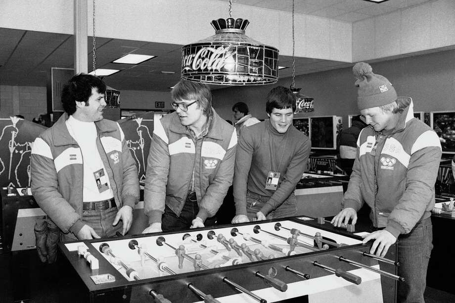 In this Feb. 10, 1980 file photo, U.S. Olympic hockey players, from left, Michael Eruzione, Phil Verchota, John Harrington and Bob Suter play foosball in the game room of the Olympic village in Lake Placid, N.Y. Photo: The Associated Press File Photo  / AP
