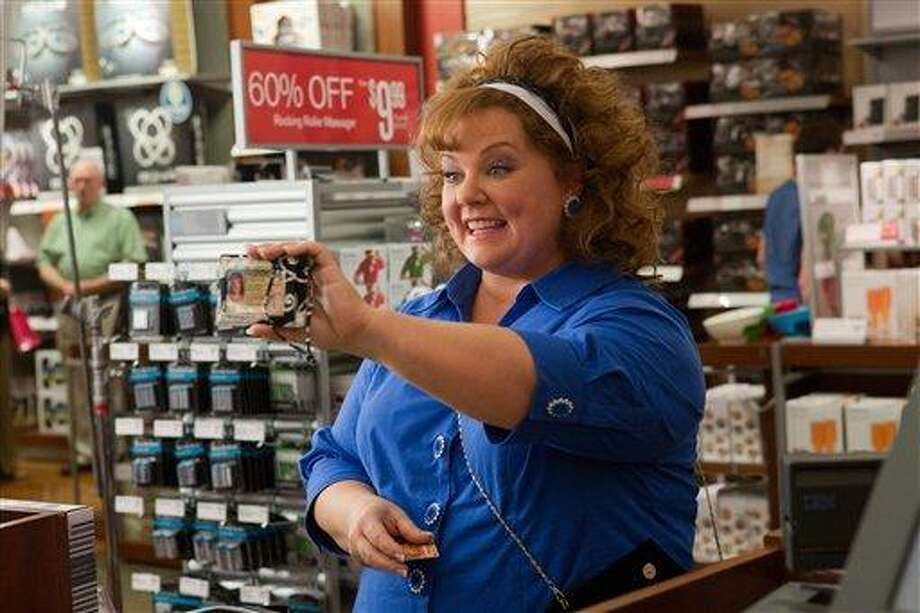 """This undated publicity image released by Universal Pictures shows Melissa McCarthy in a scene from, """"Identity Thief."""" (AP Photo/Universal Pictures) Photo: AP / Universal Pictures"""