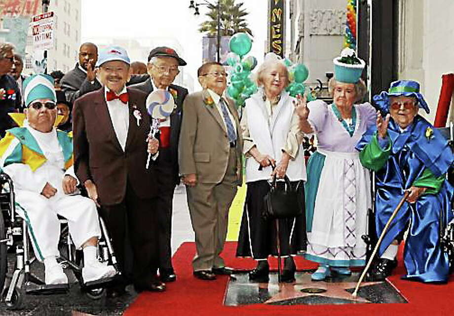 Munchkins gather to accept star on the Hollywood Walk of Fame. Mickey Carroll is third from left. Photo: AP File Photo