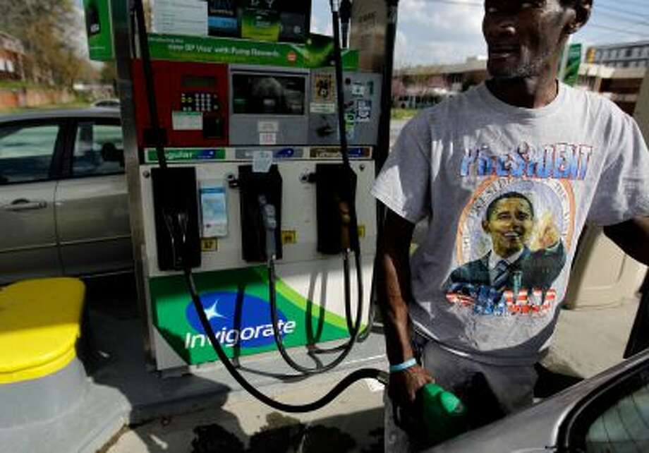 In this March 16, 2012, file photo, Henry Rice, of Atlanta, pumps gas, at a station in Atlanta. Photo: AP / AP2012