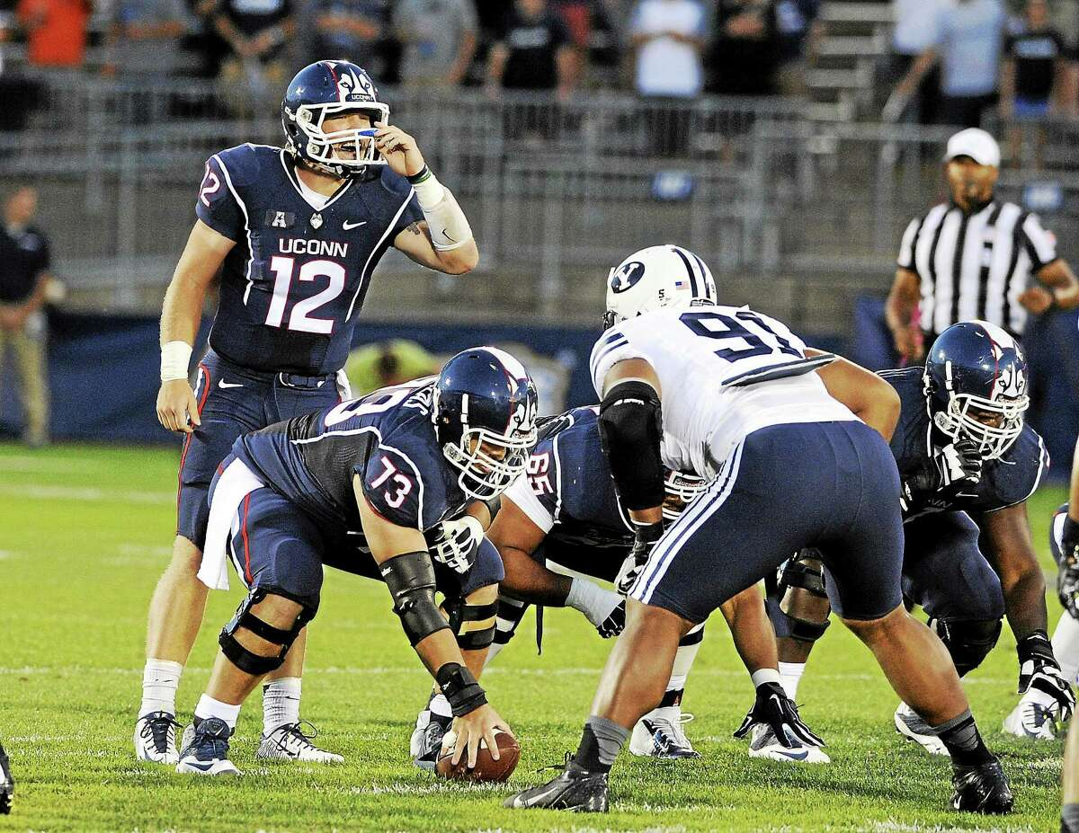 UConn quarterback Casey Cochran (12) calls out a play during the first half of the Huskies' season opener against BYU at Rentschler Field in East Hartford on Aug. 29.