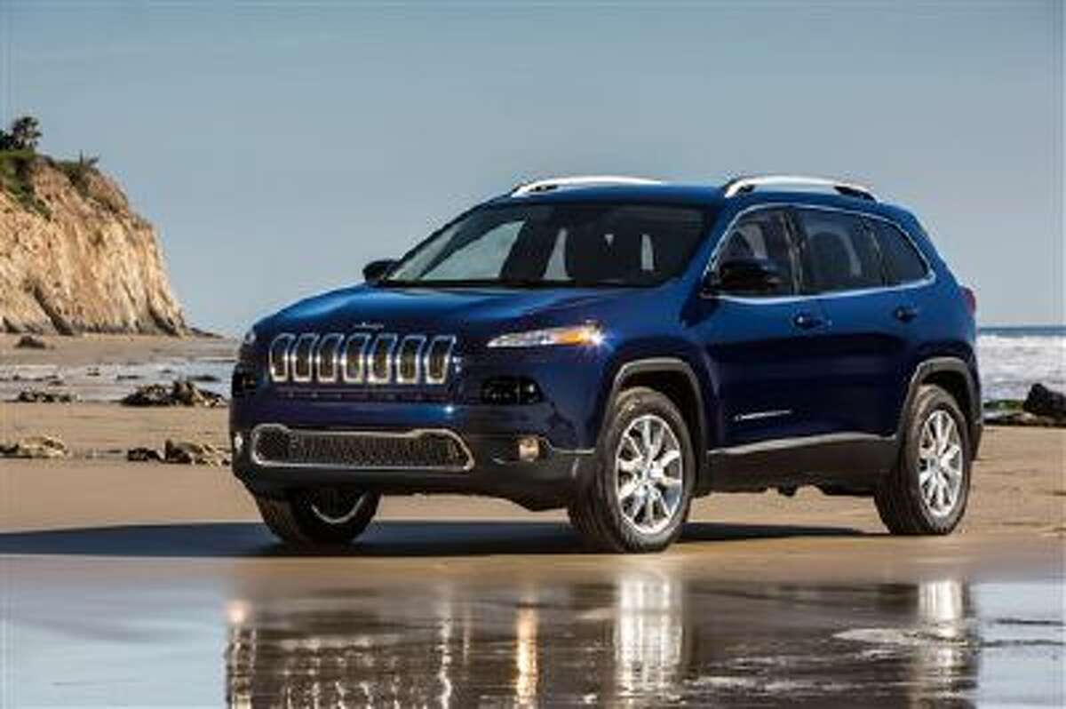 This undated file photo provided by Chrysler Group LLC shows the 2014 Jeep Cherokee Limited. Chrysler began shipping the new Jeep Cherokee, Tuesday, Oct. 22, 2013, giving dealers a long-awaited entry in the fast-growing compact crossover SUV market.