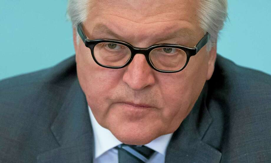 German Foreign Minister Frank-Walter Steinmeier listens to Odessa governor Igor Palitsa during a meeting in Odessa, Ukraine, Tuesday, May 13, 2014. Germanyís foreign minister on Tuesday tried to broker a quick launch of talks between Ukraineís central government and pro-Russia separatists, yet fighting still claimed six lives in restive eastern Ukraine.  (AP Photo/(AP Photo/Vadim Ghirda) Photo: AP / AP