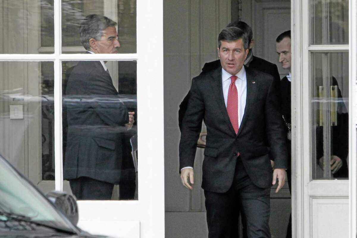 U.S Ambassador to France Charles H. Rivkin, right, leaves the Foreign Ministry in Paris, after he was summoned Monday, Oct. 21, 2013. The French government had summoned the ambassador to explain why the Americans spied on one of their closest allies. Le Monde newspaper said Monday, Oct. 21, 2013 that documents leaked by Edward Snowden show that the U.S. National Security Agency swept up 70.3 million French phone records in a 30-day period. (AP Photo/Claude Paris)
