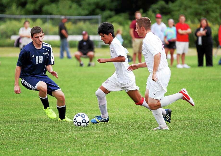 Torrington's Kevin Vaca controls the ball against Ansonia on Tuesday. Photo: Marianne Killackey — Special To Register Citizen  / 2014