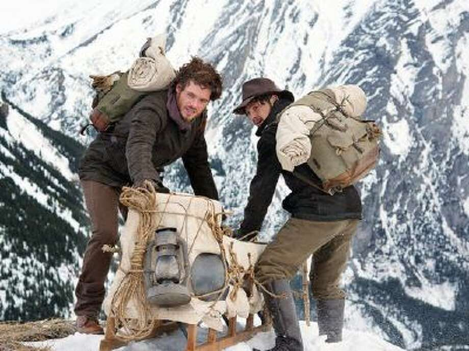 Richard Madden, left, and Augustus Prew hitch their wagon to 'Klondike.'
