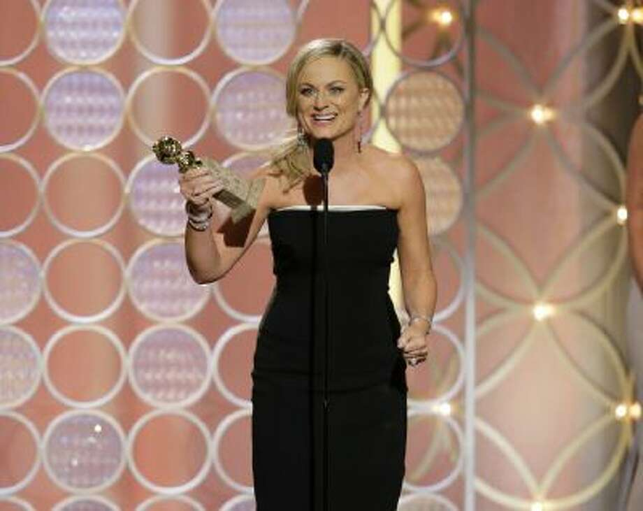 "This image released by NBC shows Amy Poehler accepting the award for best actress in a comedy series for her role in ""Parks and Recreation"" during the 71st annual Golden Globe Awards at the Beverly Hilton Hotel on Sunday, Jan. 12, 2014, in Beverly Hills, Calif."