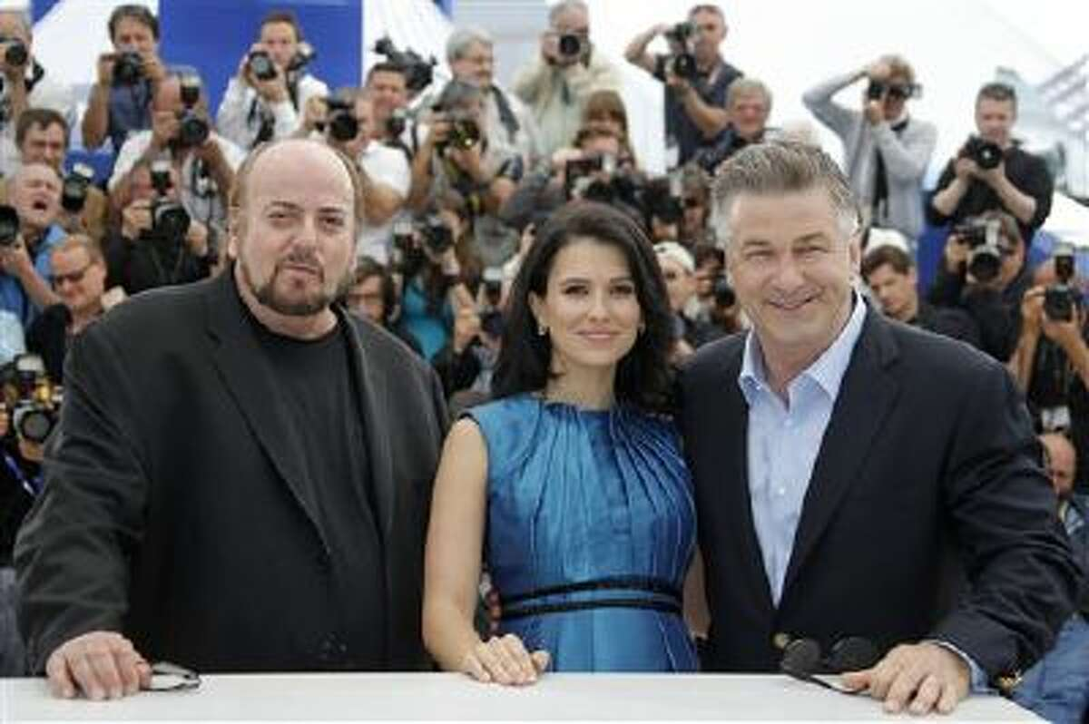 director James Toback, left, actor Alec Baldwin, right, and Baldwin's wife Hilaria Thomas pose for photographers during a photo call for the film