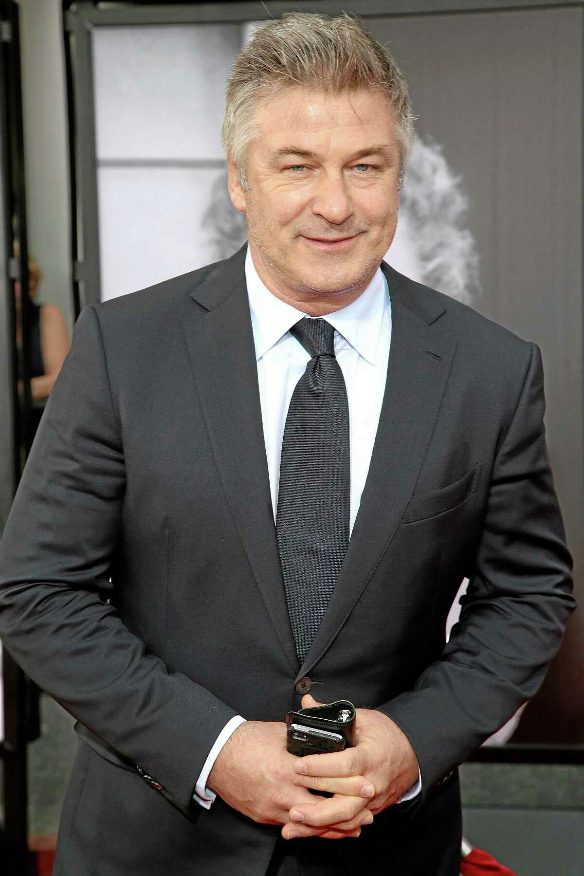 This April 10, 2014, file photo shows actor Alec Baldwin at the 2014 TCM Classic Film Festival's Opening Night Gala in Los Angeles. Police in New York City say actor Alec Baldwin has been arrested for riding a bike the wrong way on the street and acting belligerently toward the arresting officers.